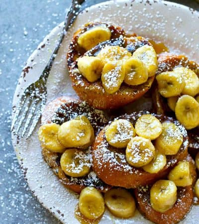 Chai-spiced french toast is topped with a killer caramelized banana sauce for the ultimate breakfast combo! Perfect for brunch for a crowd or just a lazy weekend morning.