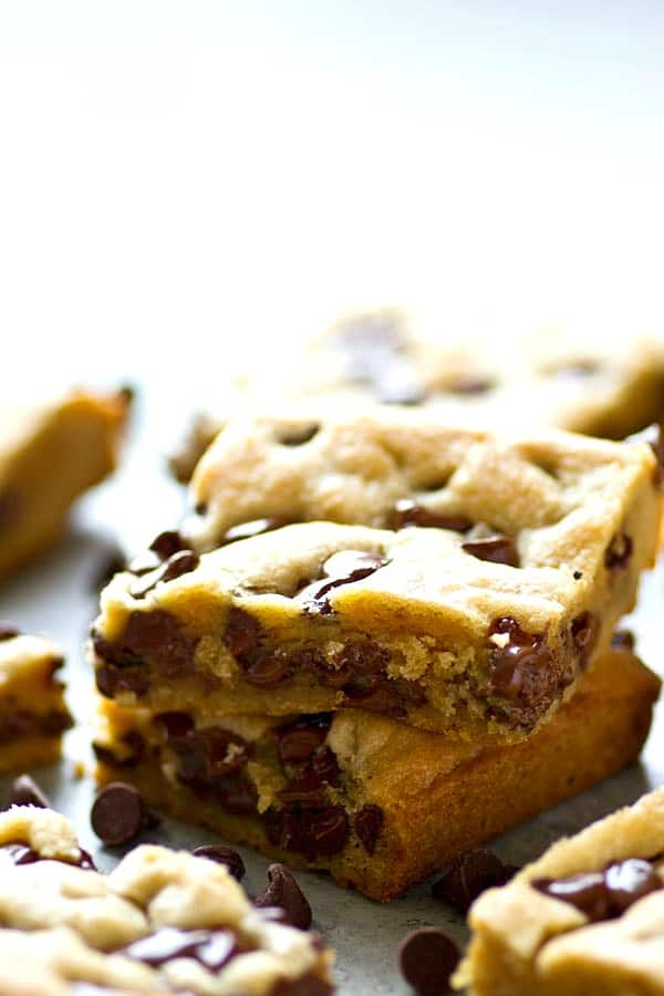 Coconut oil transforms these soft-baked coconut oil chocolate chip cookie bars into seriously the SOFTEST and most addicting cookie texture ever. You'll never make any other cookie again.