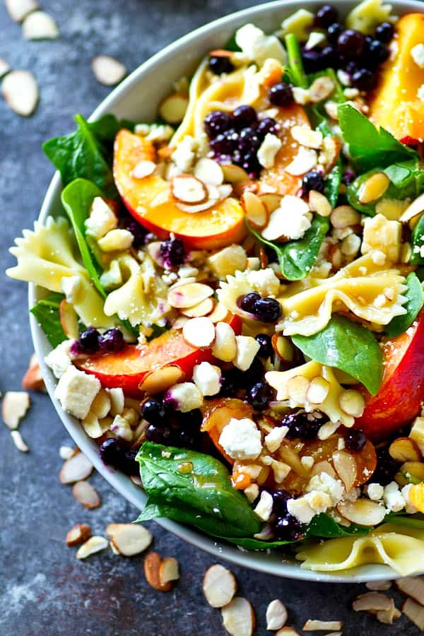 Loaded with fresh summer peaches and blueberries and tossed in a flavorful Asian dressing, this feta spinach pasta salad is going to become a staple on your summer salad lineup!