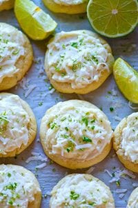 Soft lime-flavored sugar cookies are a match made in heaven with a dreamy coconut frosting heaped on top! These lime sugar cookies will be a hit anywhere you take them.
