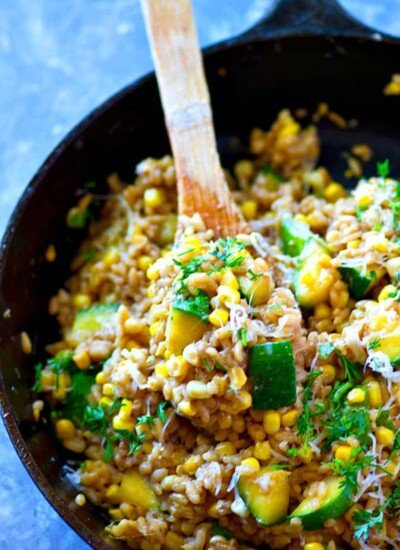 This seasonal sweet corn zucchini Parmesan risotto is super-creamy and packed with tender zucchini and fresh sweet corn. Made entirely in one skillet in only 30 minutes!