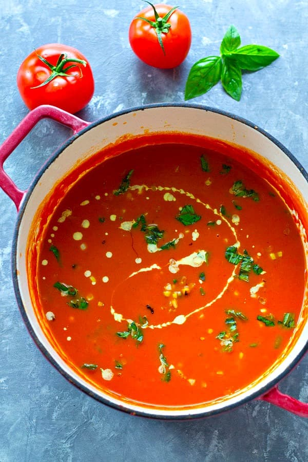 This creamy basil roasted tomato soup is pure summer in a bowl! Roasted garden tomatoes, fresh basil, and charred sweet corn pack in so much incredible flavor.
