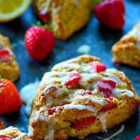 A tangy lemon glaze and winning combo of strawberries and lemonade collide in these incredibly flaky strawberry lemonade scones.---Super easy to make and a brunch stunner!