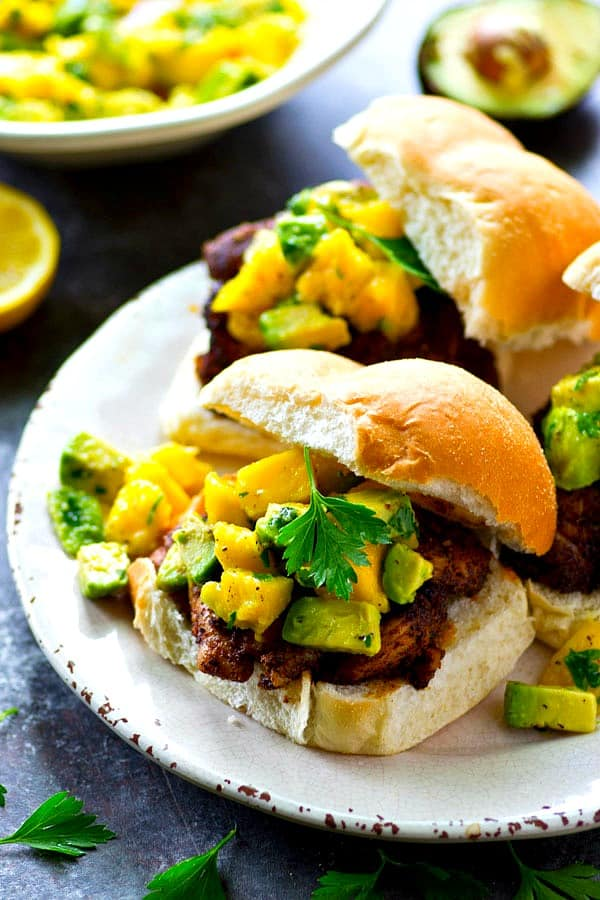 A smoky blackened spice rub coats every inch of these juicy grilled blackened chicken sandwiches and a silky mango avocado salsa is piled high on top for the ultimate summer sandwich!