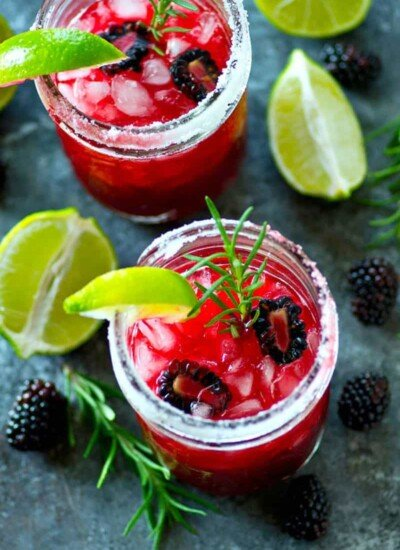 Sweet blackberries and fragrant rosemary are the perfect match in these refreshing blackberry rosemary margaritas.--Gorgeous cocktail choice for a fancier sipper!
