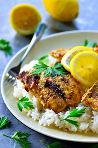 Traditional tandoori grilled salmon is marinated in a spiced yogurt marinade, grilled until tender, and piled on top of fluffy lemon basmati rice.--it'll quickly become a dinner regular!