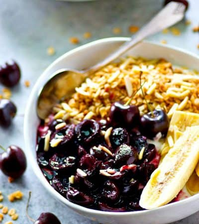 Juicy roasted cherries and sliced bananas are the ultimate breakfast combo in these granola yogurt bowls! Fast and nutritiousfor a busy morning breakfast.