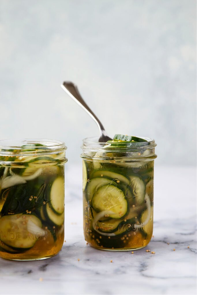 These refrigerator bread and butter pickles are made entirely in the fridge overnight and perfectly crisp, sweet, and tangy. - perfect for using up a bounty of cucumbers!