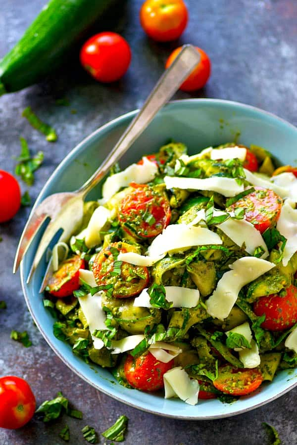 Smooth, garlicky roasted garlic spinach pesto coats every inch of this summery zucchini ribbon salad and it's all tossed with tons of juicy cherry tomatoes and grated Parmesan.