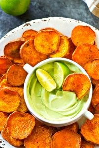 Kickin' cajun lime sweet potato chips are perfectly crisp with just the right amount of heat and cooled down with a creamy avocado dip.--just try to eat only one!