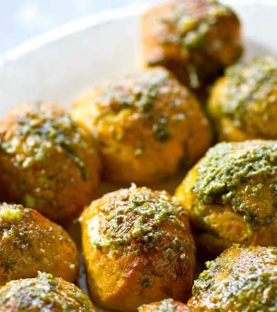 Soft pretzel bites could not be EASIER to make at home! These Parmesan pesto soft pretzel bites are unbelievably soft, chewy, and covered in flavorful pesto and Parmesan cheese.