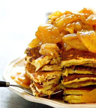 Browned butter adds so much flavor these fluffy cornmeal pancakes and they're stacked up tall with a homemade apple pear compote piled on top!