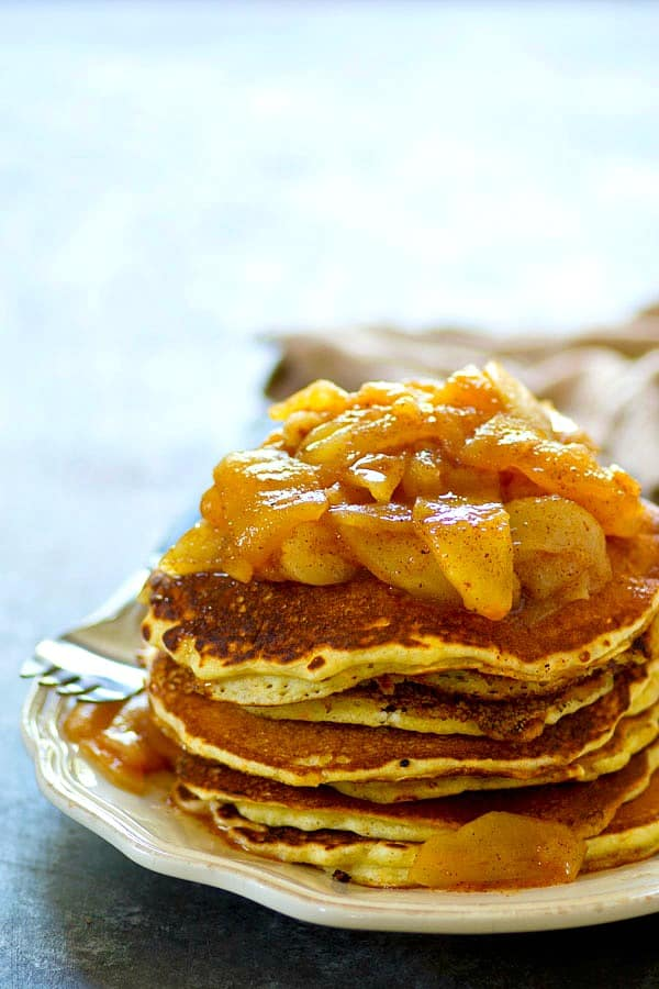 Browned butter adds so much flavor in these fluffy cornmeal pancakes and they're stacked up tall with a homemade apple pear compote piled on top!