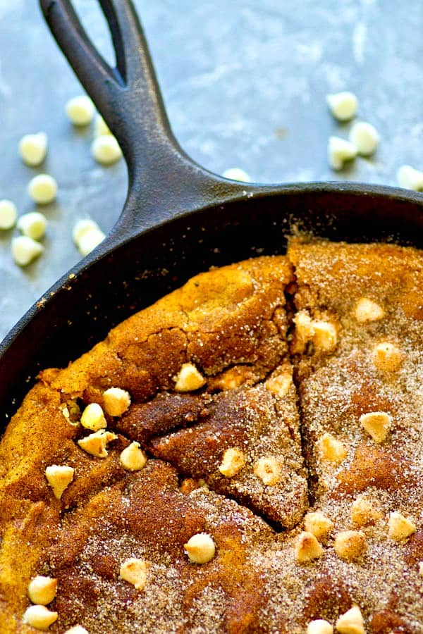 White chocolate and pumpkin are the ultimate combo in this INCREDIBLY soft snickerdoodle skillet cookie! Whips up in one bowl in minutes for whenever you've got a cookie craving.