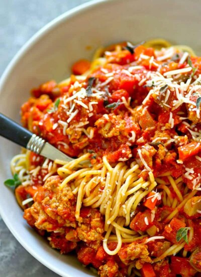 Hearty, flavorful turkey sausage bolognese sauce is made in mere MINUTES in the instant pot and it tastes like it simmered all day! Serve it fresh over noodles or freeze it for later.