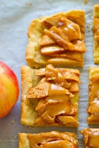 A soft sugar cookie crust collides with everything you love about caramel apples in this beautiful sugar cookie caramel apple slab pie! Perfect for a last-minute holiday dessert!