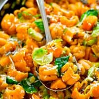 Shaved brussels sprouts and soft delicata squash cubes star in this loaded zucchette pasta skillet dinner that's super easy to throw together and packed full of healthy goodness!