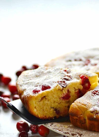 Incredibly soft and moist cranberry chai spice ricotta cake is the ultimate holiday cake for your dessert table! Chock-full of tangy cranberries, chai flavors, and a simple dusting of powdered sugar.