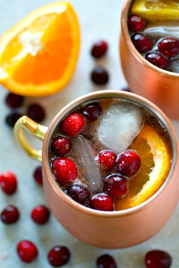 Tangy cranberries and citrus-y orange are the perfect fall flavor canvas for these gorgeous cranberry orange Moscow mules! Shake them up in minutes for the perfect holiday cocktail!