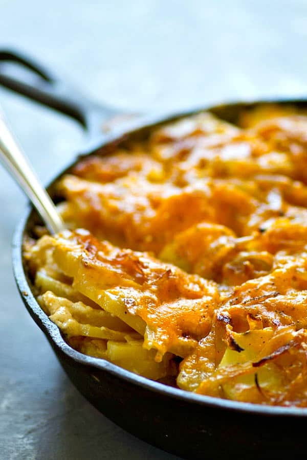 Creamy, comforting smoked cheddar caramelized onion scalloped potatoes are the ultimate holiday side dish to add to your menu! Easy to make and such a huge crowd-pleaser.