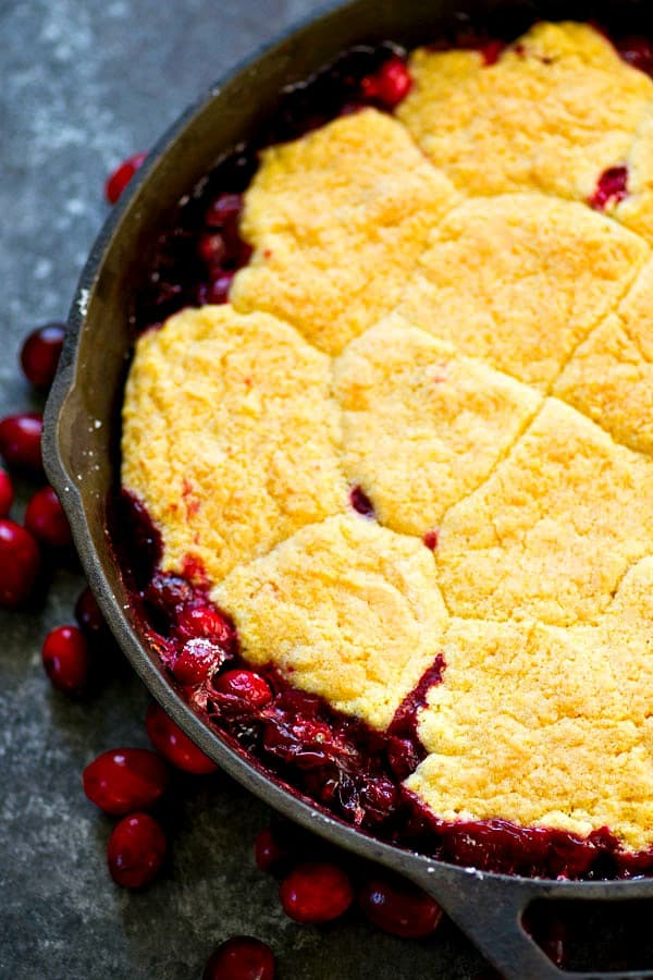 Tangy cranberries and a soft cookie-like browned butter cornmeal topping are an unbeatable holiday combo in this easy cranberry browned butter cornmeal cobbler!
