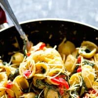 A creamy mascarpone sauce, roasted red peppers, and spinach are the most flavorful trio in this easy skillet orechiette pasta!