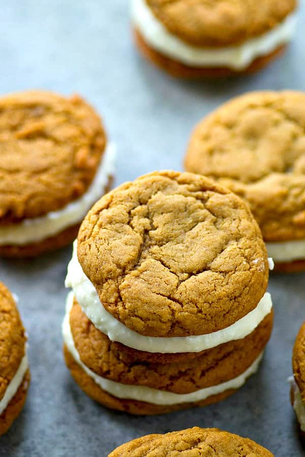 Soft gingerbread cookies meet a creamy white chocolate cream cheese filling in these festive gingerbread white chocolate sandwich cookies! Perfect for any cookie tray.