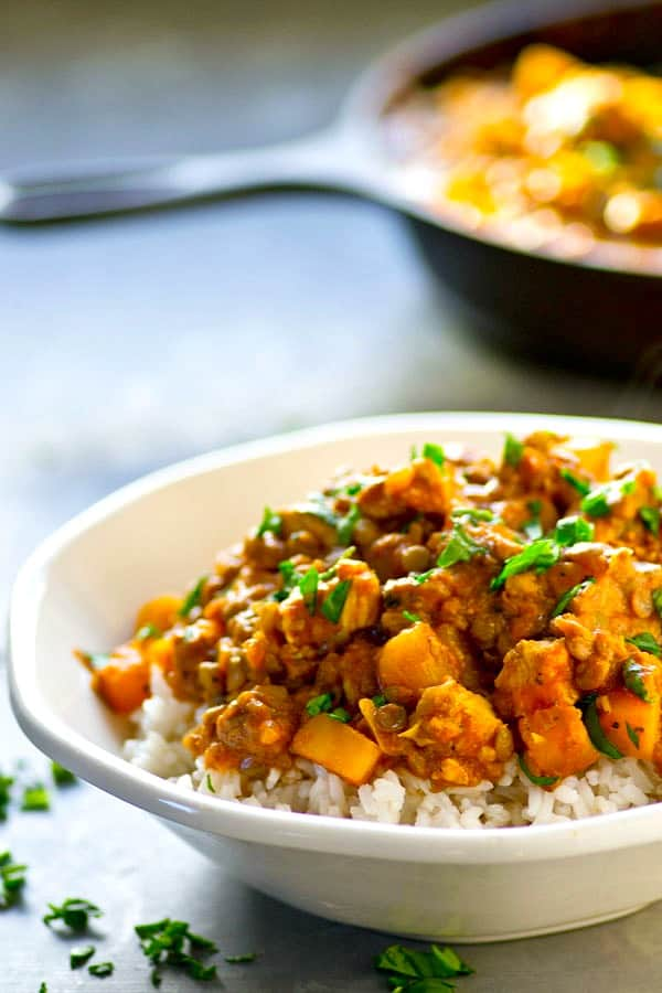 Soft delicata squash and hearty lentils collide in this incredibly flavor-packed lentil delicata squash chicken curry! Serve over hot fluffy rice for a hearty, healthy winter meal.