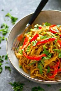 Sweet peppers and fragrant basil add SO much incredible flavor to these peanut thai noodles! Ready in minutes and 10x better than any take-out!