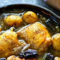 This white wine braised chicken is simple comfort food fancified! Tender chicken thighs are braised in flavorful white wine with lots of tender baby potatoes and mushrooms.