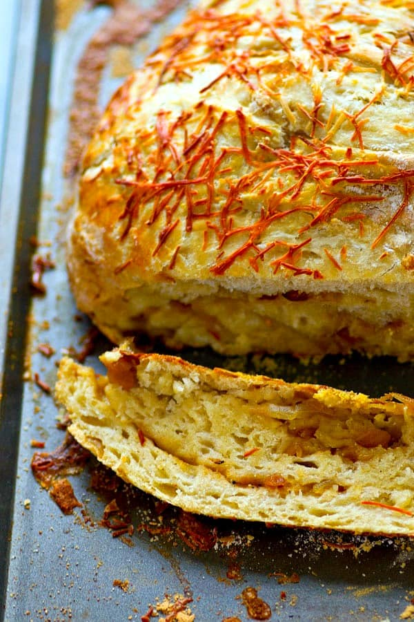 Flavorful caramelized onion and sharp asiago cheese are the perfect duo in this stunning asiago no-knead bread! Its made overnight for easy baking the next day and SO incredibly tender and flavorful!