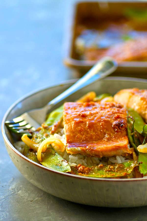 Made entirely on one sheet pan and ridiculously easy, this hoisin salmon and snow peas is soon to become a dinner regular!--you can't beat the homemade hoisin sauce!