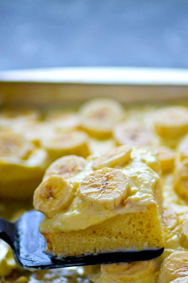 This banana cream pie sheet cake is a DEAD ringer for the classic pie! It's made easy in sheet cake form and destined to become a cake favorite!