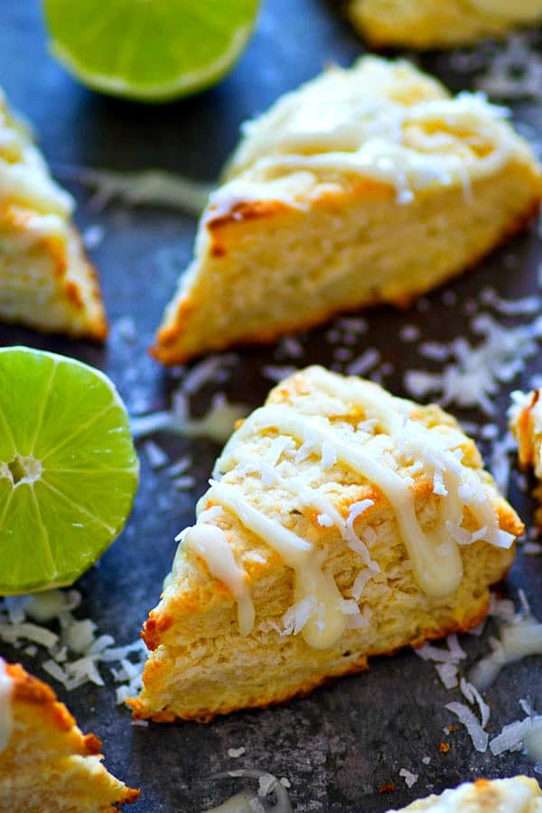 Coconut and key lime are the BEST combo in these incredibly tender and buttery coconut key lime pie scones.---Like key lime pie in breakfast form!