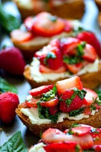 Fresh strawberries get macerated with basil and piled high over toasted bread and creamy mascarpone. You won't be able to get enough of this strawberry basil mascarpone bruschetta!