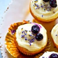 Fragrant lavender and juicy blueberries join forces in these SUPER soft blueberry lavender cream cheese cupcakes crowned with a silky cream cheese frosting.