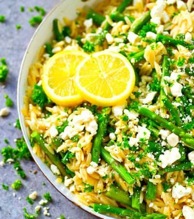 A zingy browned butter lemon sauce coats every inch of this spring-like asparagus feta orzo skillet that's SUPER easy to throw together for a quick, healthy dinner!