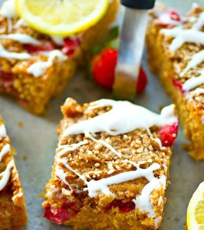 Need a brunch item that'll wow guests? This strawberry lemon crumb coffee cake is SUPER gorgeous and jam-packed with juicy strawberries, buttery crumb topping, and lots of lemon glaze!