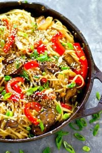 Lo mein noodles are tossed in a sesame sauce with tender sauteed shiitake mushrooms and sweet peppers for the ultimate take out-style dinner! Make a double batch for awesome leftovers.