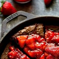 Incredibly fudgy deep-dish mocha brownie pie is piled high with juicy homemade strawberry preserves for the BEST brownie dessert you could ever dream of!