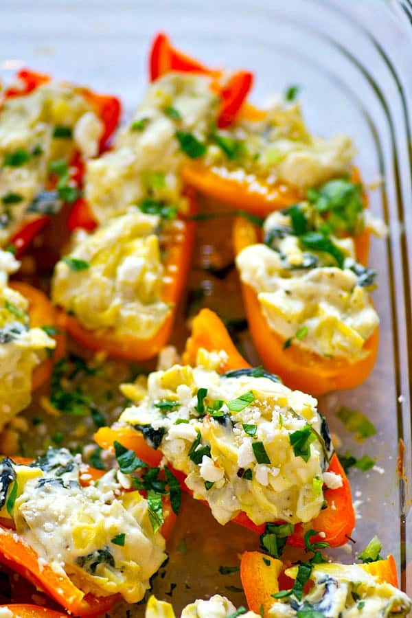 Stuffed with the killer combo of spinach artichoke, these creamy feta stuffed sweet peppers are gonna be in HIGH demand for any kind of entertaining appetizer!