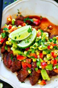 A spicy homemade blackened seasoning coats every inch of this grilled blackened steak that's served with a zippy charred corn avocado salsa piled over top!