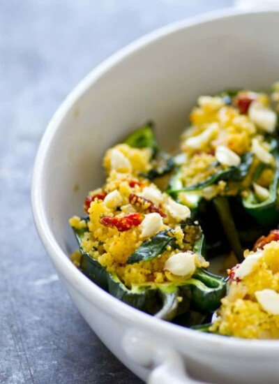 Stuffed to capacity with soft goat cheese, tender couscous, and flavorful sun-dried tomatoes, these stuffed poblano peppers are a cinch to put on the dinner table and PACKED with flavor!