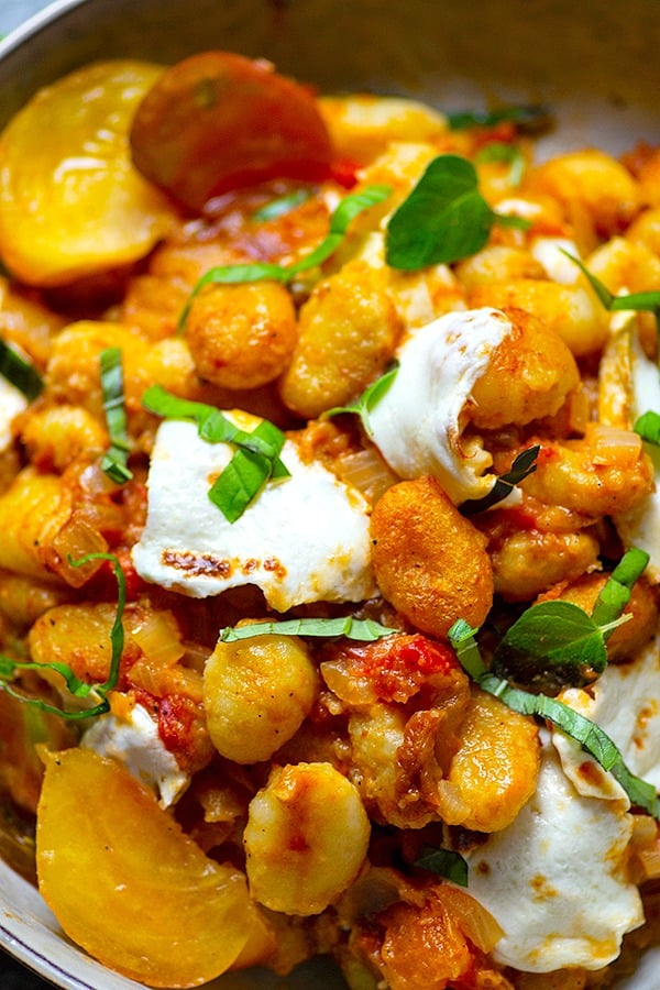 Juicy roasted heirloom tomatoes and creamy fresh mozzarella make the most amazing flavor duo in this summery mozzarella gnocchi skillet that you'll have on the table in MINUTES!