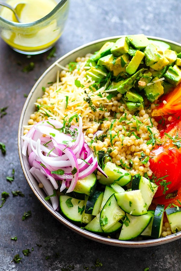 Juicy fresh heirloom tomatoes and silky avocado bring incredible summer flavors to this colorful Israeli couscous salad that's easy to throw together and a STUNNER for any summer table!
