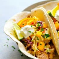 Citrus-Grilled Chicken Tacos with Mango Jalapeno Slaw - Juicy citrus-marinated grilled chicken and a zingy fresh mango jalapeno slaw are the taco duo your taco dinner game NEEDS!