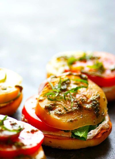 Open-Faced Heirloom Tomato Goat Cheese Bagel Sandwiches - Creamy goat cheese and ULTRA-juicy heirloom tomatoes join forces and take these summery open-faced goat cheese bagel sandwiches to the next level!