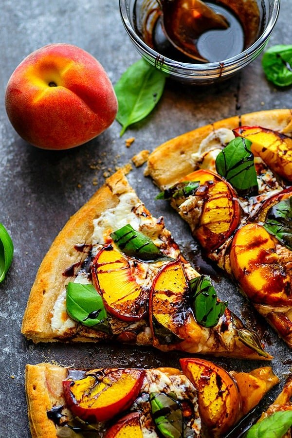 Juicy summer peaches and a tangy balsamic glaze take this caprese pizza WAY up a notch in the summer department! Perfect for a summer pizza night.