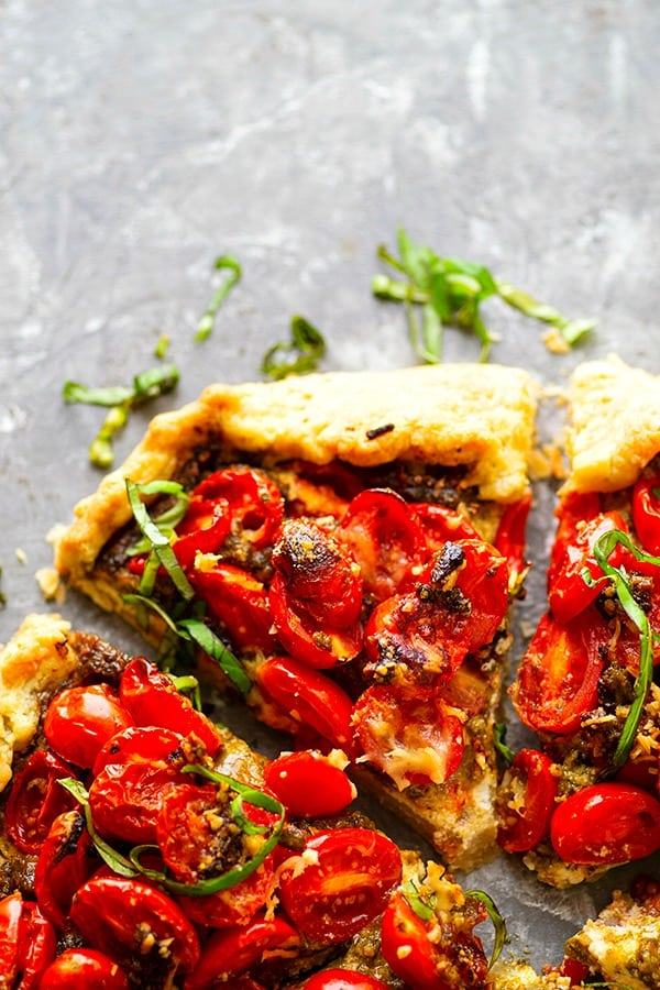 Ricotta Basil Pesto Cherry Tomato Galette - Creamy ricotta and flavorful basil pesto compliment sweet summer-fresh cherry tomatoes incredibly in this beautiful summertime cherry tomato galette!
