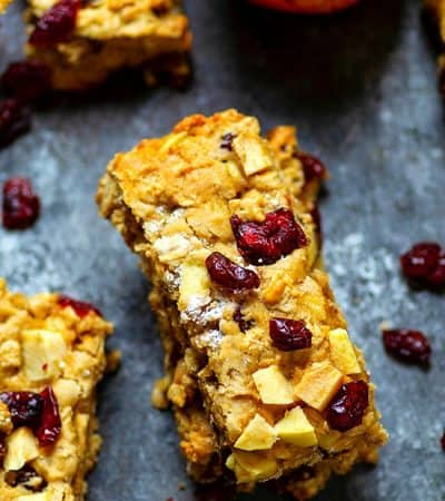 Cranberry Apple Oatmeal Breakfast Bars - Grab 'n' go breakfast don't get much better than these cranberry apple oatmeal breakfast bars! They're SUPER filling, incredibly soft, and packed with chewy cranberries and soft apple pieces!